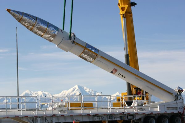 A ground-based missile interceptor is lowered into its missile silo during a ...