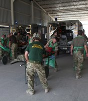 Military medics outside Camp Bastion hospital receive a battlefield casualty.