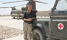 Presenter Michael Mosley in Camp Bastion, Afghanistan. The Medical Emergency Response Team (MERT) Chinook helicopter is in the background. Camp Bastion is the headquarters for coalition forces in Afghanistan.