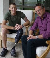 U.S. Marine, Corporal Chuck Donnelly with presenter Michael Mosley.