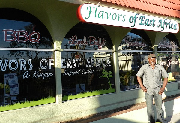 June Owino, in front of his restaurant, Flavors of East Africa.