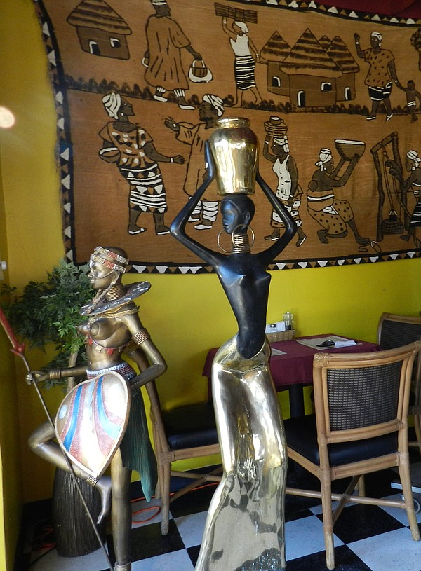 Kenyan art displayed around the restaurant.