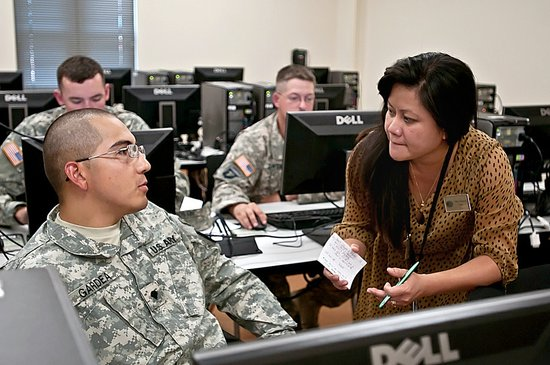 Soldiers at Joint Base Lewis-McChord manage their education records and request Tuition Assistance, July 2012.