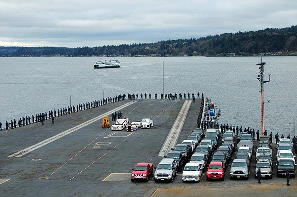 The USS Ronald Reagan heads out towards its return to San...