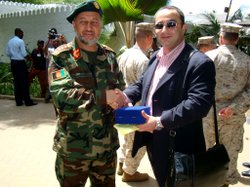 Iranian-American interpreter Amir Estakhri with Gen. Bismullah Kahn Mohammadi, then-Chief of General Staff for the Afghan National Army, during 2009 talks in Kenya.