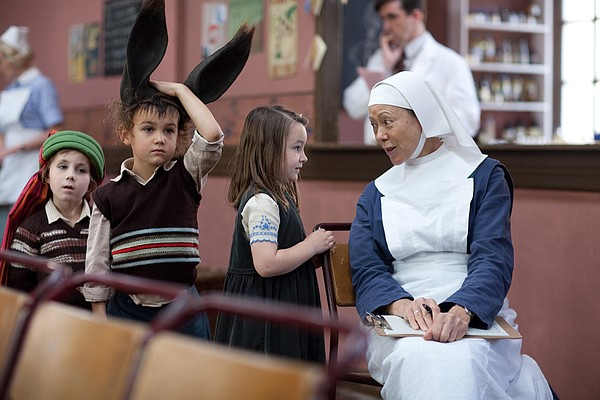 Children with Jenny Agutter as Sister Julienne.