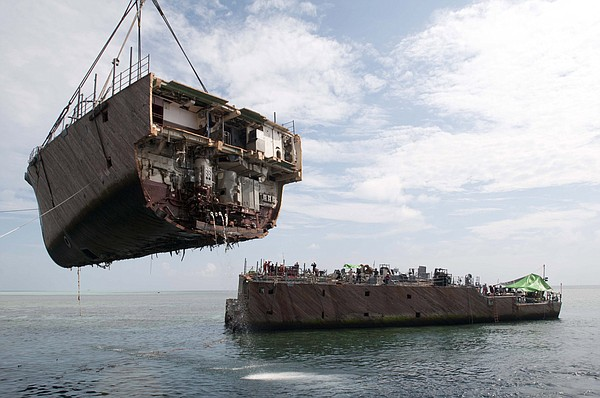 The bow of the mine countermeasure ship Ex-Guardian (MCM 5) is removed by the...