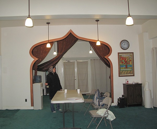 Naeema, Amir Carr's wife, stands in the masjid's archway.