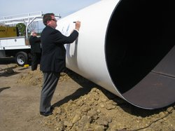 Tom Wornham, Chair of the San Diego County Water Authority, signs the casing for the pipe to bring desalinated water from the coast to blend with the region's water supply