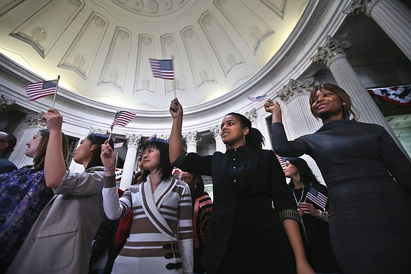 Immigrants celebrate after becoming American citizens at a naturalization cer...