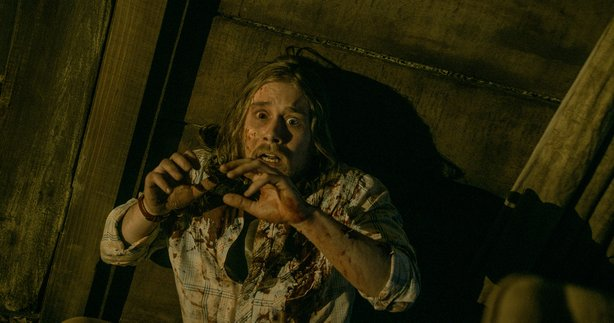 "Lou Taylor Pucci as Eric in ""Evil Dead."""