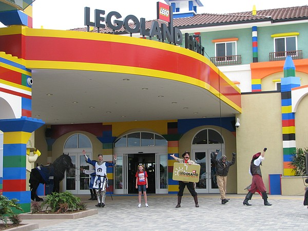 A young girl welcomes visitors to Legoland's new hotel, A...