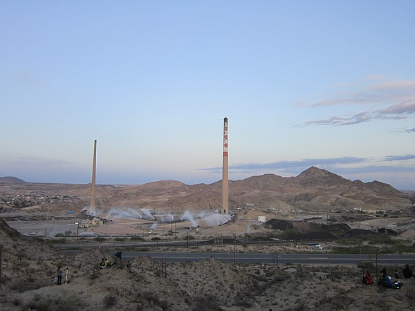 A pair of smokestacks that dominated the skyline between the border cities of...