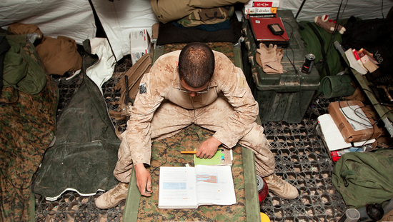 U.S. Marine studies a mathematics textbook in his sleeping area on Jan. 31.