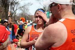 A runner reacts near Kenmore Square after two bombs exploded during the 117th Boston Marathon on April 15, 2013 in Boston, Massachusetts.