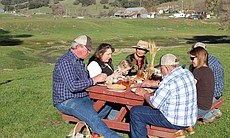 Mendenhall Family enjoying a meal with Su-Mei Yu, Mendenhall Ranch.