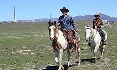 Su-Mei Yu and Joel Mendenhall exploring Mendenhall Ranch on horseback.