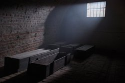 Coffins in the in the basement of the Terezin concentration camp.