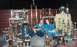 Carolyn and Allen Fisher surrounded by their trophies. They once donated 400 ...