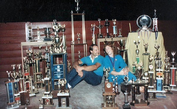Carolyn and Allen Fisher surrounded by their trophies. Th...