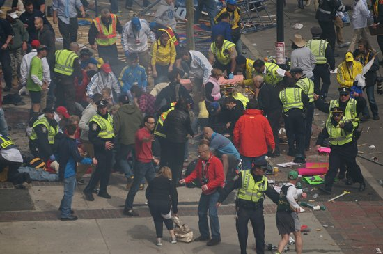 First responders aid the injured after the Boston Marathon bombings.