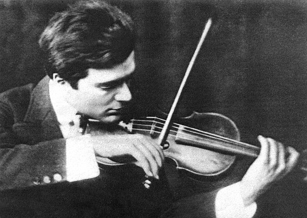 Young Bronislaw Huberman playing the violin at the height...