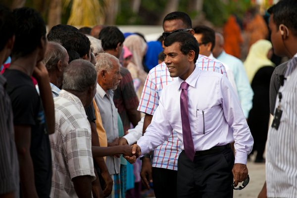 President Mohamed Nasheed greets residents of an island in the northern Maldi...