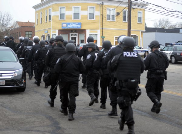 Police walk down School and Walnut Street on April 19, 2013 in Watertown, Mas...