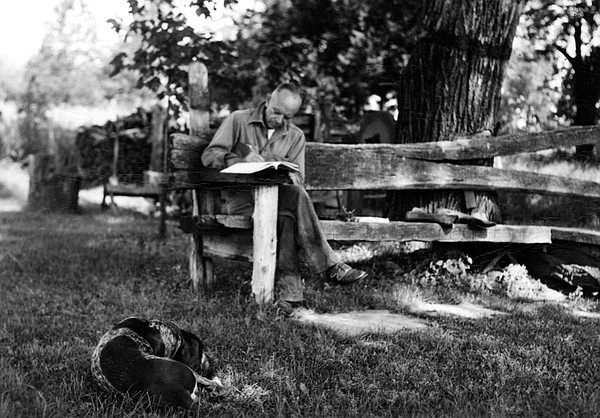 Aldo Leopold writing at the Shack.