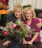Noted floral artist, educator and speaker René van Rems with host Nan Sterman and  floral arrangement.