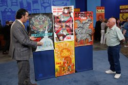 Nicholas Lowry (left) appraises a collection of David Klein TWA Posters, ca. ...