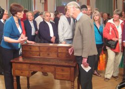 Deborah Lambert examines a desk with connections to Napoleon.