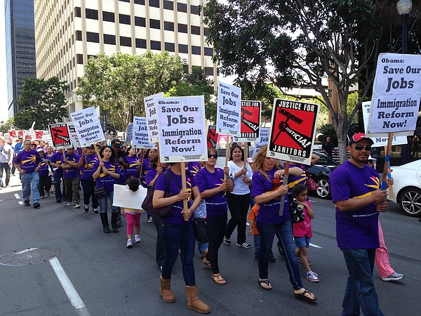 Hundreds of janitors marched through downtown San Diego o...