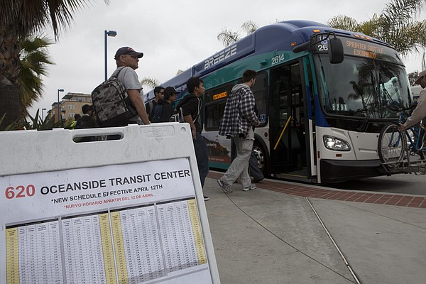 North County transit passengers catch a bus in Oceanside. Some of the passeng...