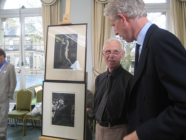 Rupert Maas examines some etchings signed by Dame Laura K...