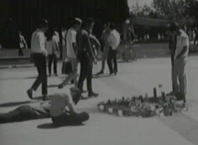 Students surround a makeshift memorial where George Winne committed suicide i...