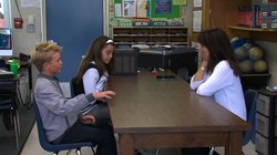 John Pyle, 10 and Ann Sugrue-Morillo, 10, talk with Cara Serban-Lawly, direct...