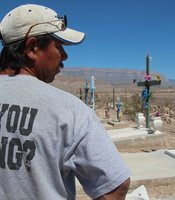 Tomas Ureste Gonzales at the grave of his brother in Boquillas, Mexico. (Photo by Lorne Matalon)