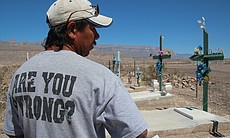 Tomas Ureste Gonzales at the grave of his brother in Boquillas, Mexico. (Phot...