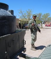 Mexican Army Private Victor Miguel Marquez guards a military vehicle in Boquillas, Mexico. (Photo by Lorne Matalon)