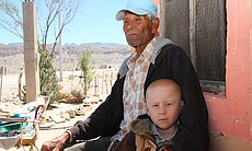 Pablos Robles with his grandnephew Derian Diaz in Boquillas, Mexico. (Photo b...