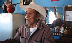 Candelario Valdez tends bar in Boquillas, Mexico. (Photo by Lorne Matalon)