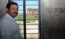Bernardo Robles owns the casita in Boquillas, Mexico. Behind him, the Rio Gra...
