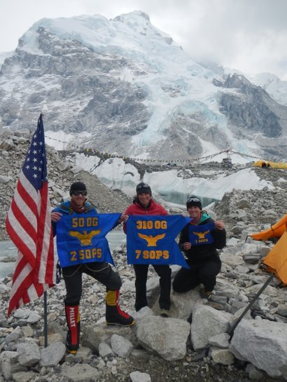 Capt. Colin Merrin, 2nd Space Operations Squadron, Capt. Heidi Kent, 7th Space Operations Squadron, and Megan Harkins, 1st Space Operations Squadron, take a moment to represent the 50th Space Wing at Mount Everest Base Camp.