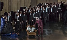 "A scene from Verdi's ""Un Ballo in Maschera"" with Kathleen Kim as Oscar and Dmitri Hvorostovsky as Count Anckarström."