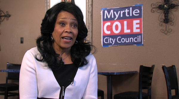 Myrtle Cole talks in her campaign office.