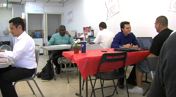 Dwayne Crenshaw makes phone calls to voters from his campaign office.