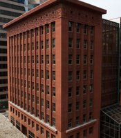 "Louis Sullivan's Wainwright Building was not the first skyscraper, but it gave the modern, steel-frame skyscraper its form. Historian Tim Samuelson said it ""taught the skyscraper to soar."""