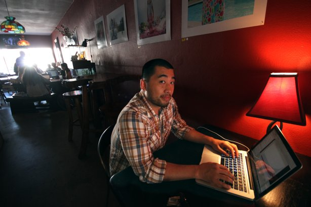 Tom Wong works in his favorite coffee shop in San Diego's North Park neighbor...