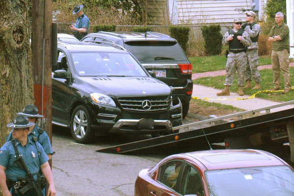 Law enforcement tows the hijacked Mercedes SUV.